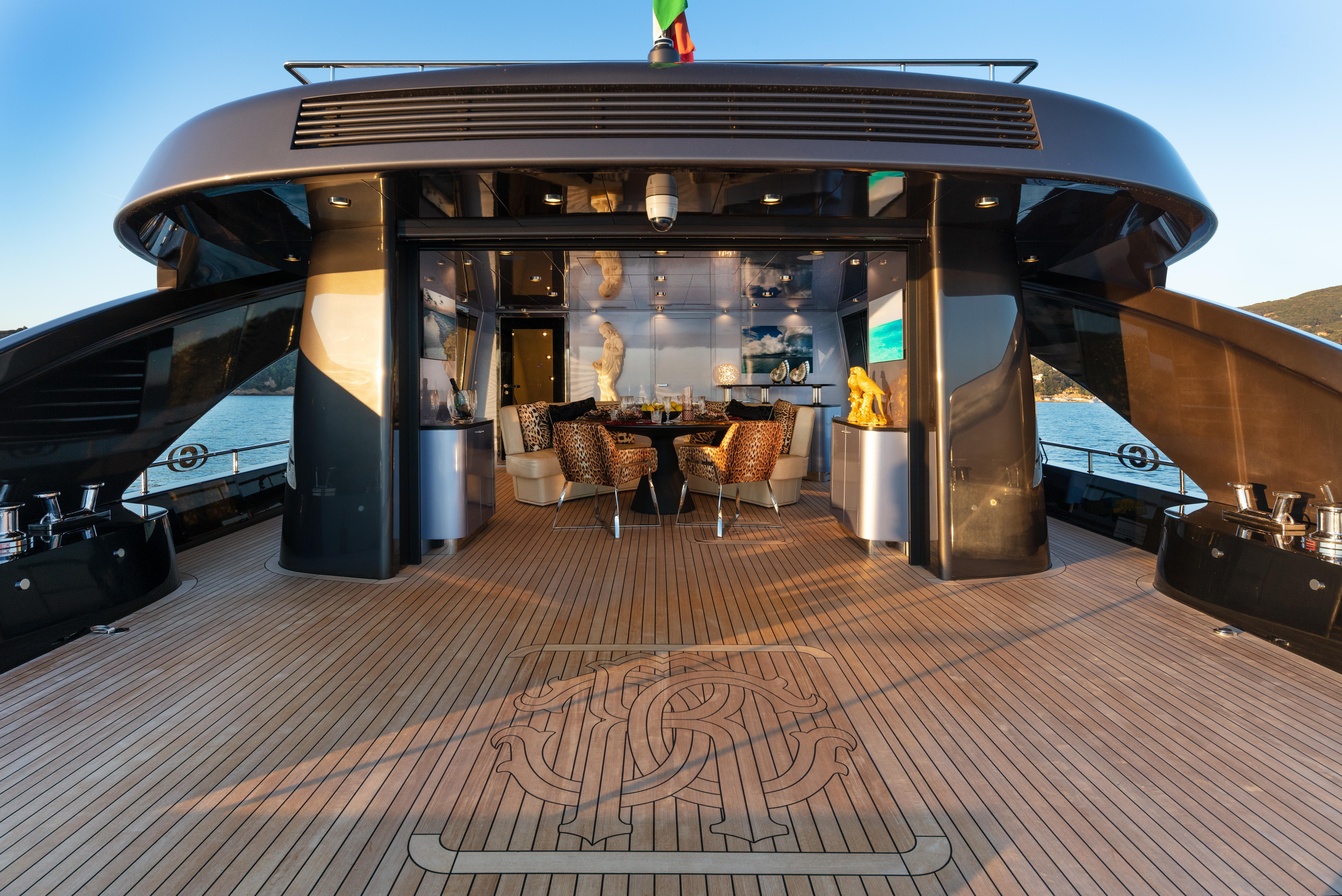 Roberto Cavalli and Tomasso Spadolini on M/Y     superyachts com